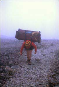 Kenny Campbell carrying the piano up the mountain.